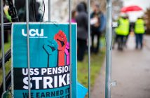 "A UCU strike ballot poster attached to railings, with the text ""USS Pension Strike"""