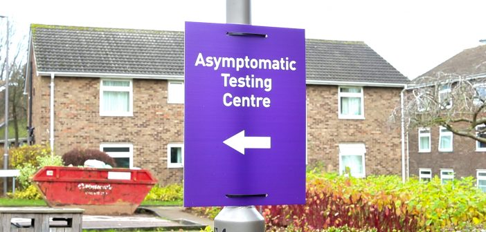 sign pointing left with the text 'asymptomatic testing centre'