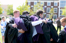 Graduates celebrating in a huddle