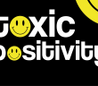 'toxic positivity' in white writing on a black background, with each of the O's replaced with a emoticon-like smiley face