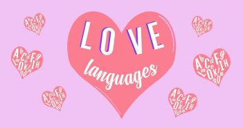 A coral pink heart with love languages in it is surrounding by smaller hearts with the alphabet inside. This is set upon a bright pink and purple background.