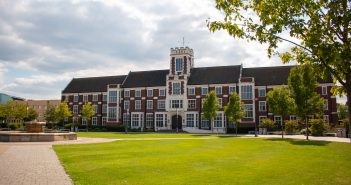 Wide photograph of the Hazlerigg building in the sun