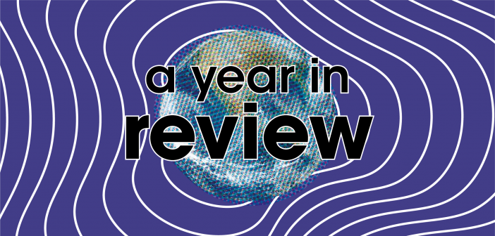 """Stylised image of the globe with the text """"a year in review"""""""