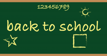 yellow text on a green chalkboard background reading 'back to school', surrounded by yellow chalk-drawn shapes