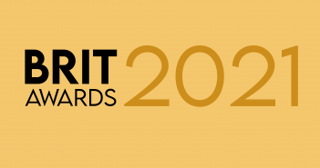 "Gold background with the text ""Brit Awards"" in black and the text ""2021"" in darker gold"